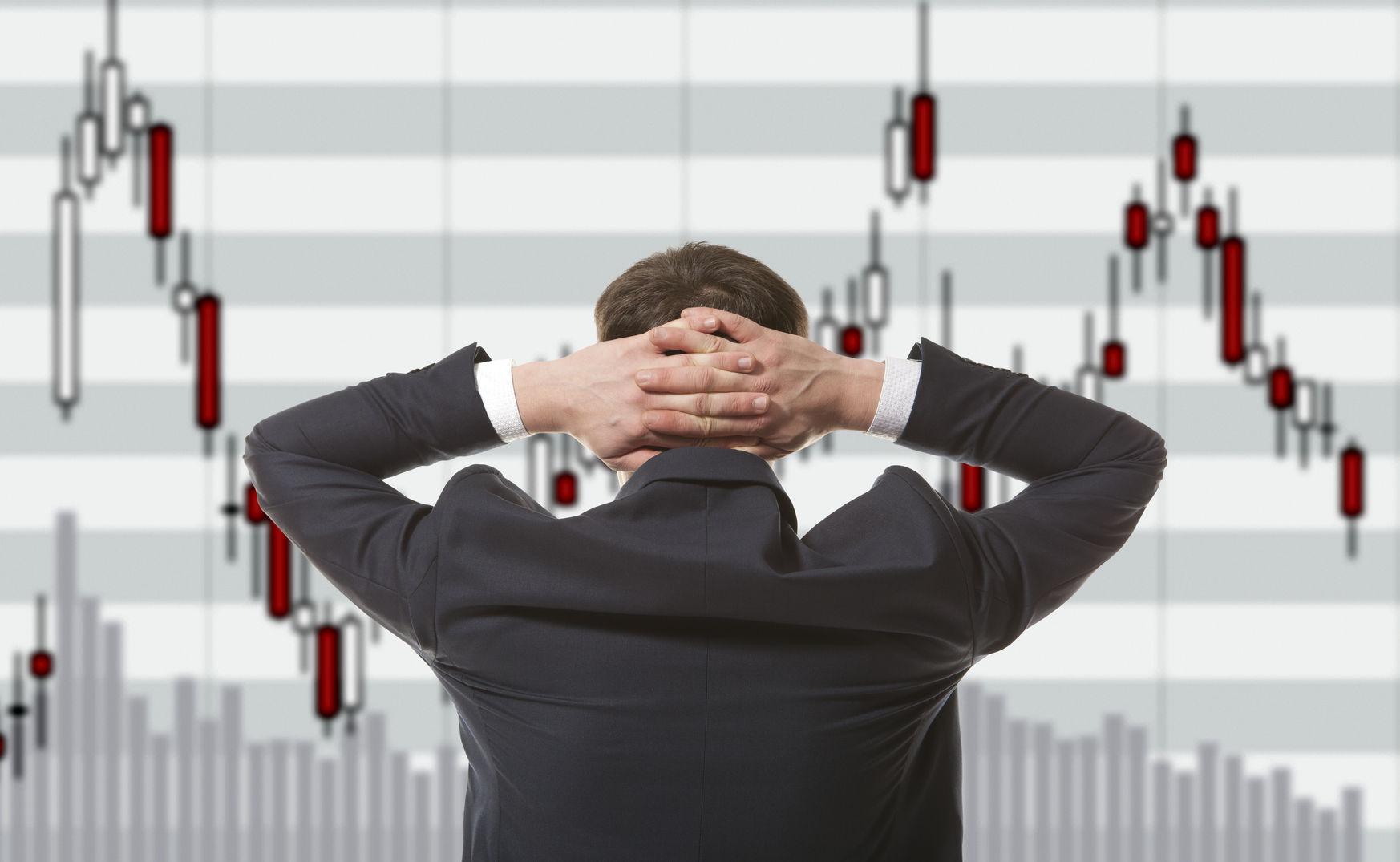 stock trader looking at monitors
