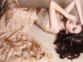 beautiful brunette wearing luxurious beige dress